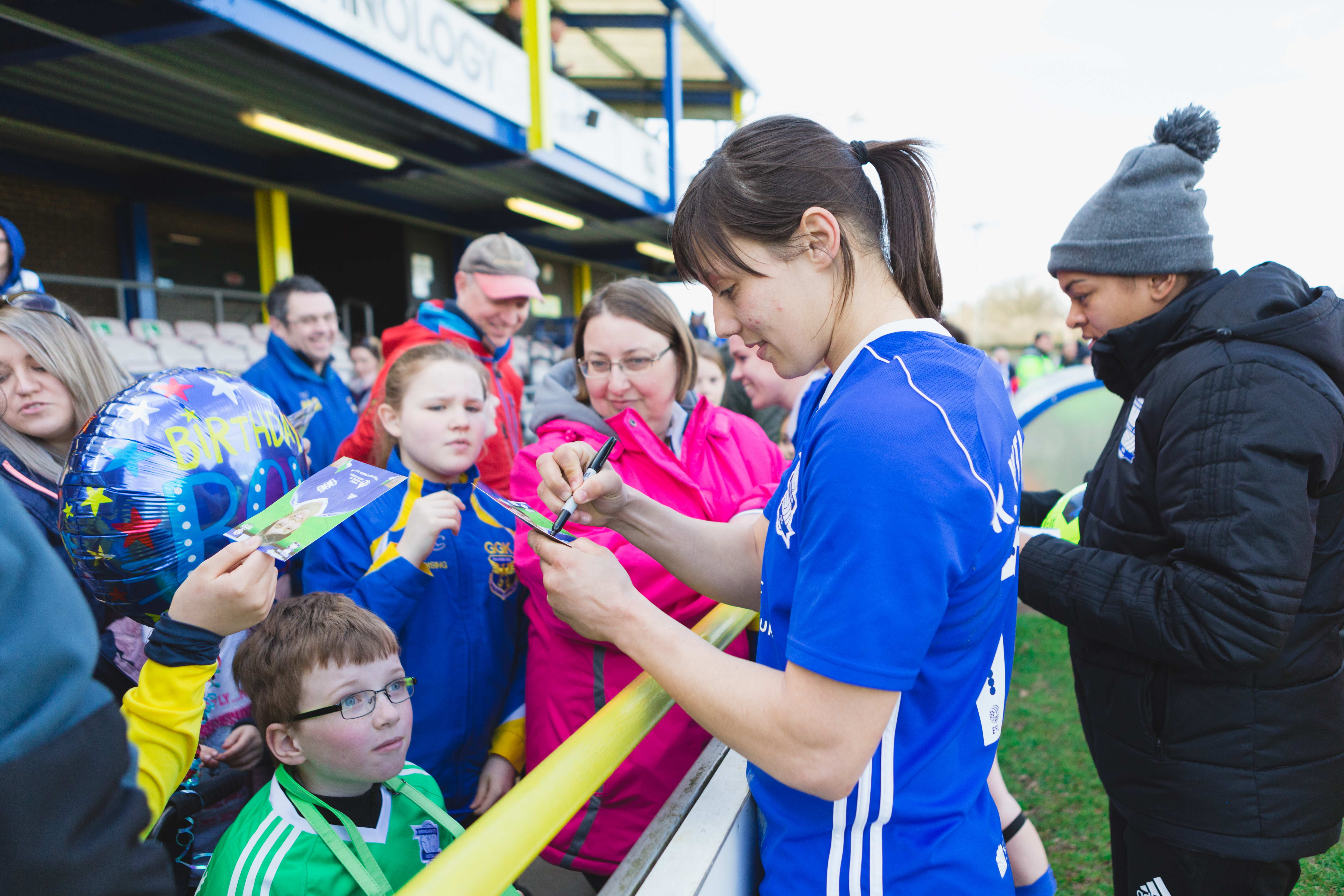 Birmingham City Ladies FC player signing autographs