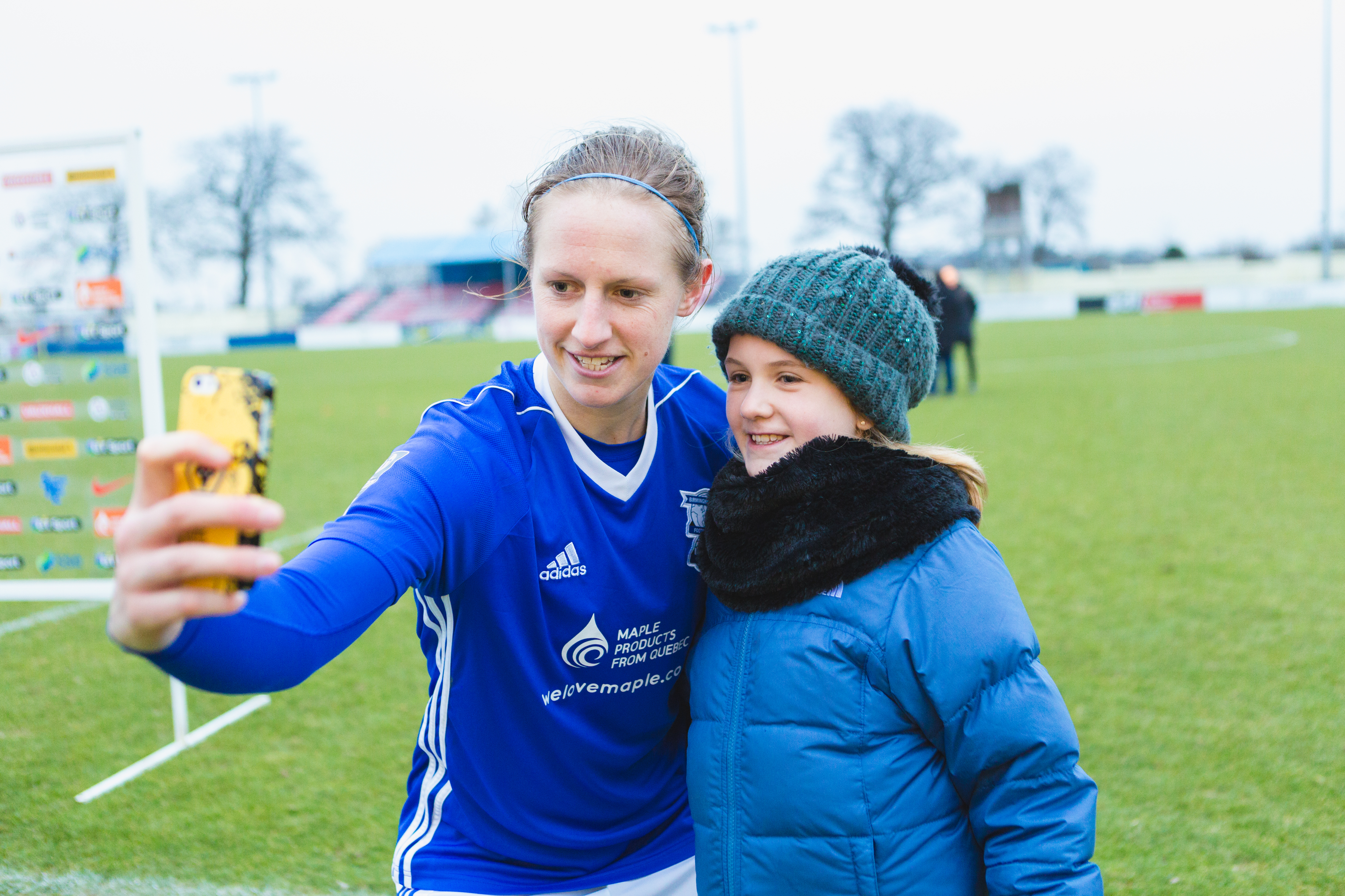 Birmingham City Ladies FC player taking a selfie with a fan