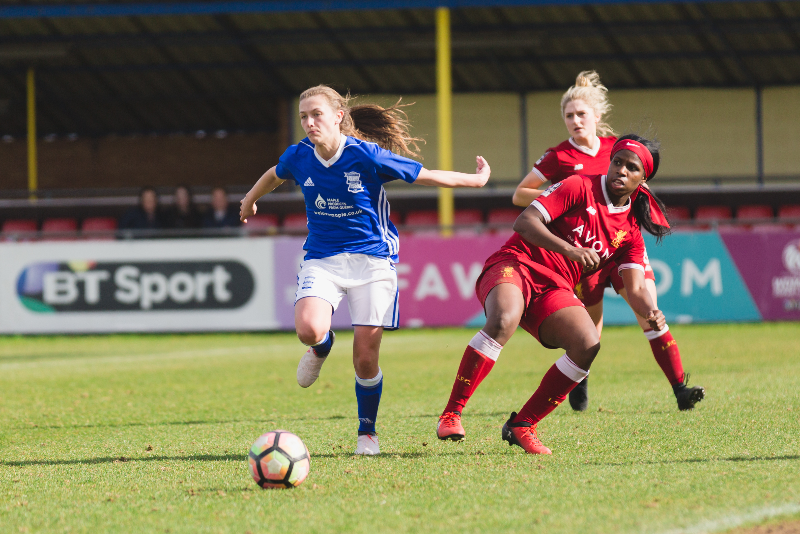 Birmingham City Ladies FC player chasing down the ball