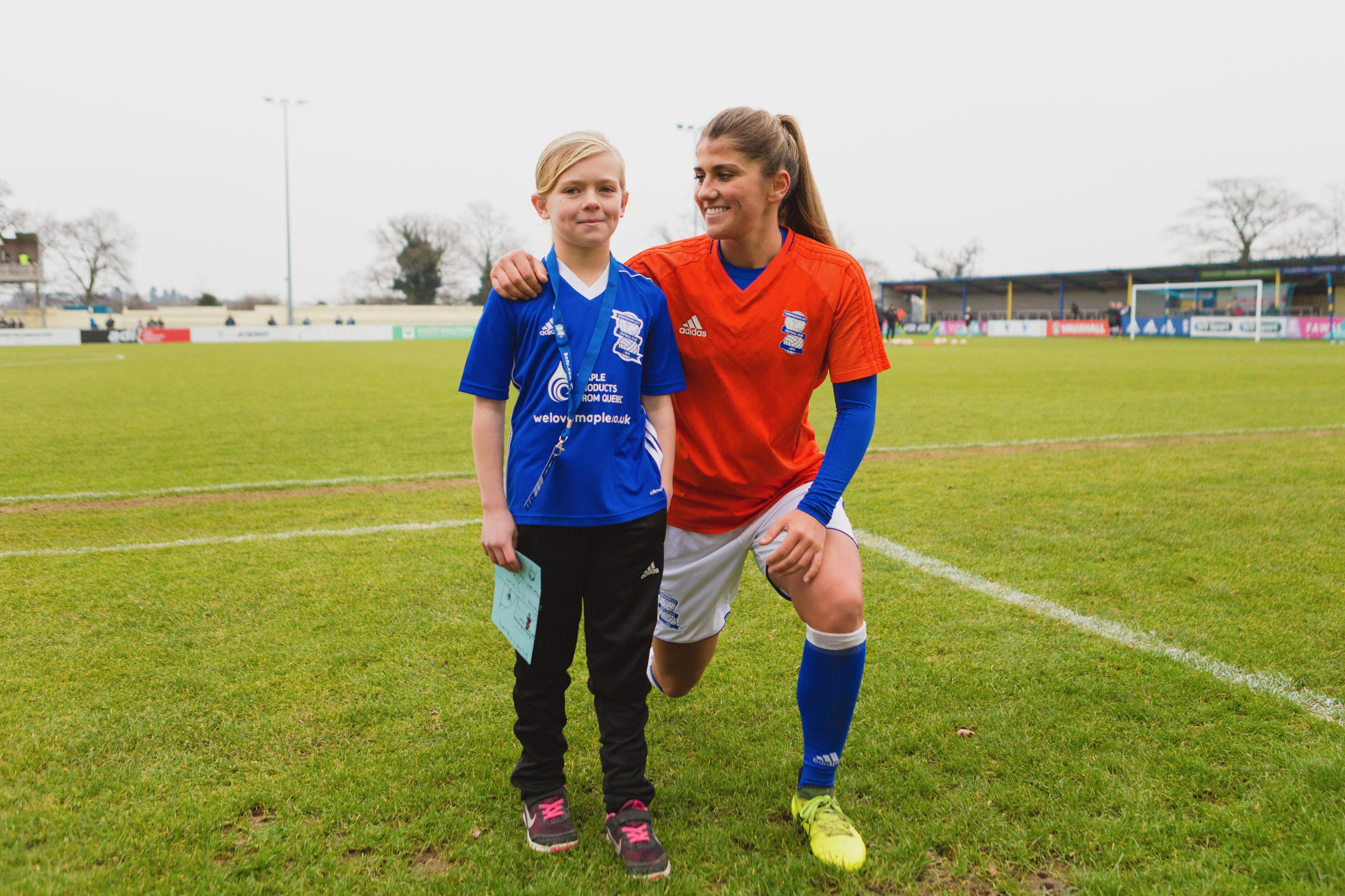 Competition winner, Kaitlyn Hicks-Kenward, with Blues defender, Paige Williams