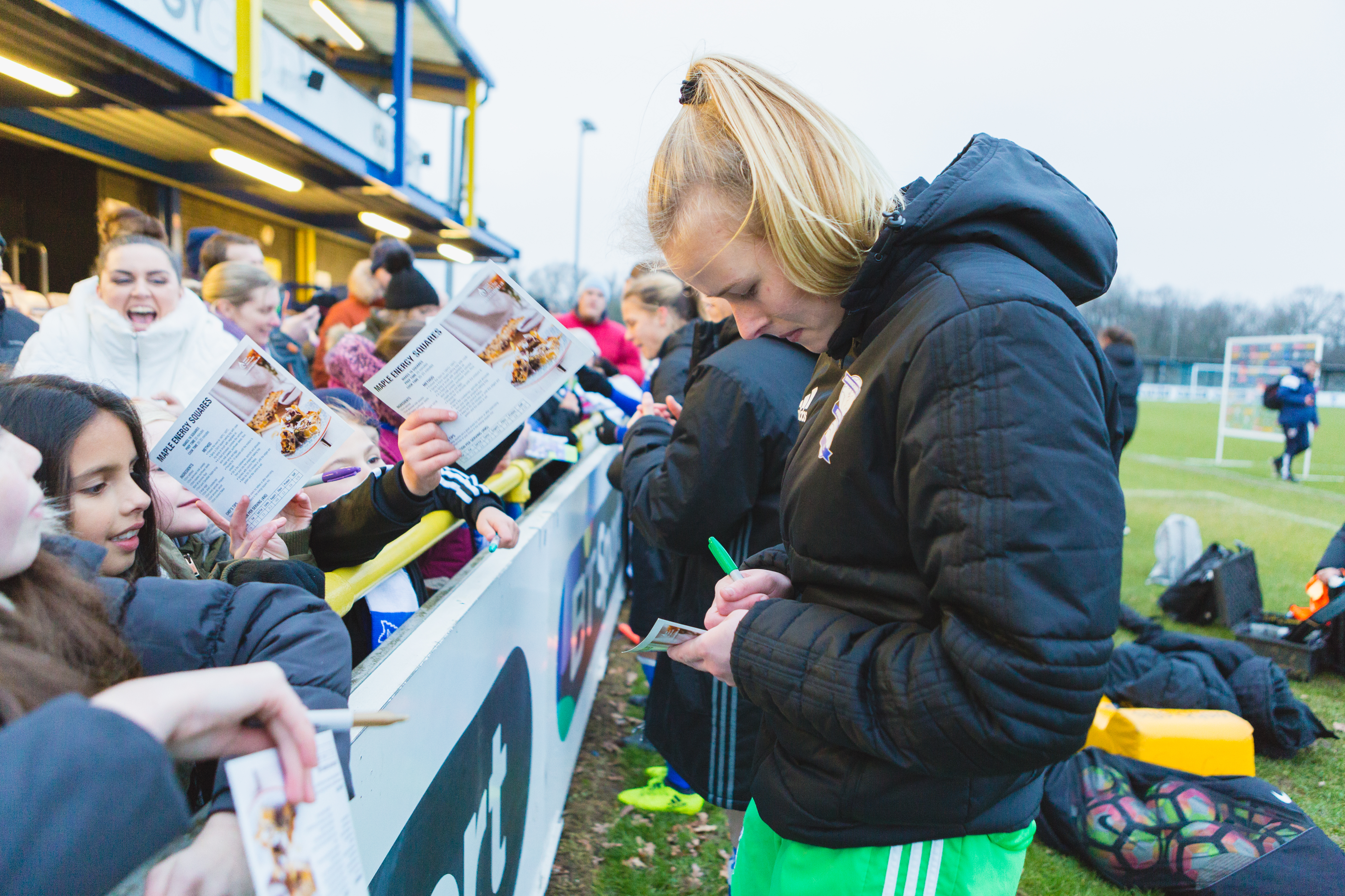 Birmingham City Ladies FC players signing autographs for young fans