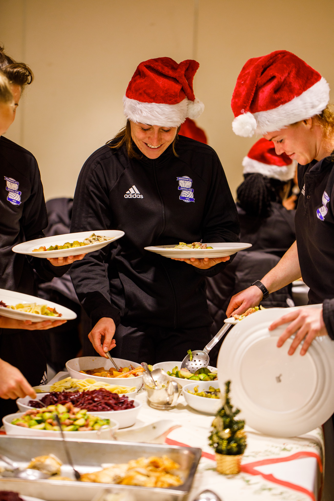 Birmingham City Ladies FC players digging into their Christmas feast they prepared