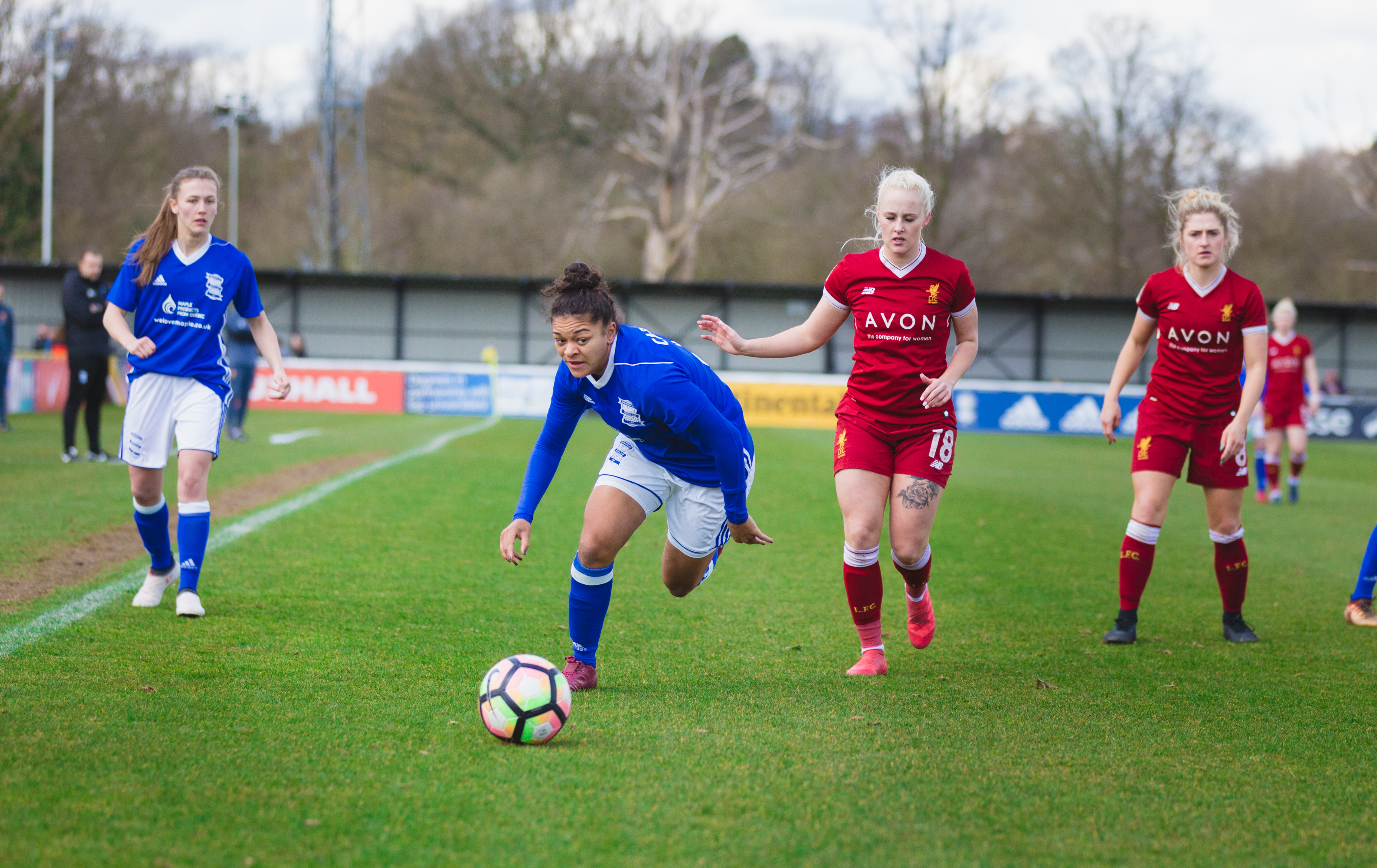 Birmingham City Ladies FC player beating opponents to the ball
