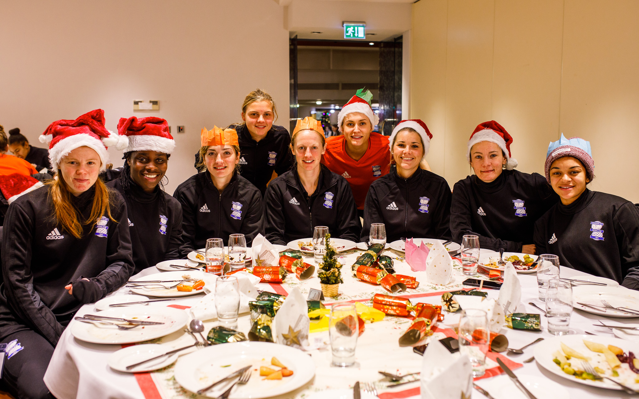 Birmingham City Ladies FC players awaiting their Christmas feast