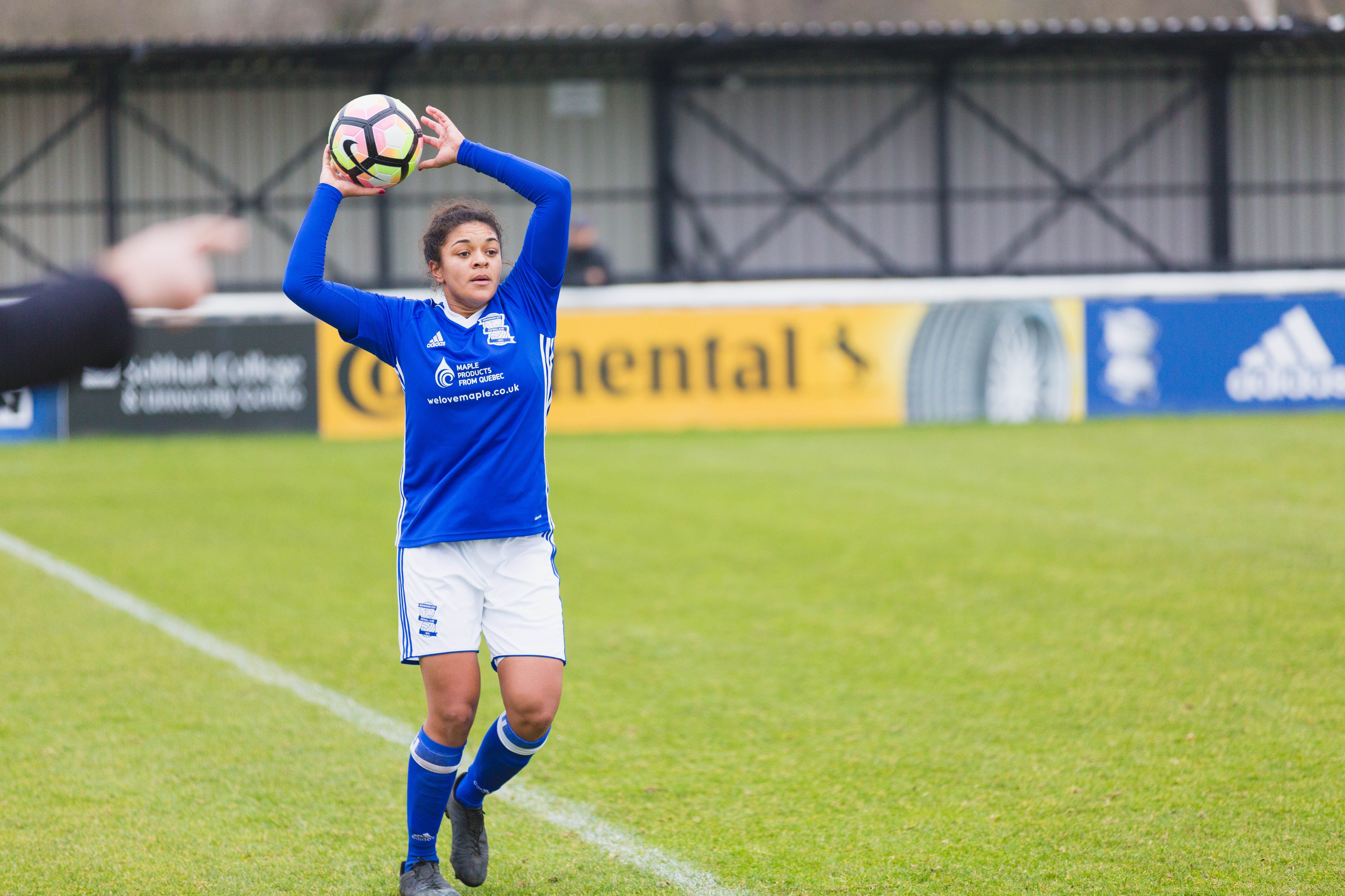 Birmingham City Ladies FC player throwing in the ball