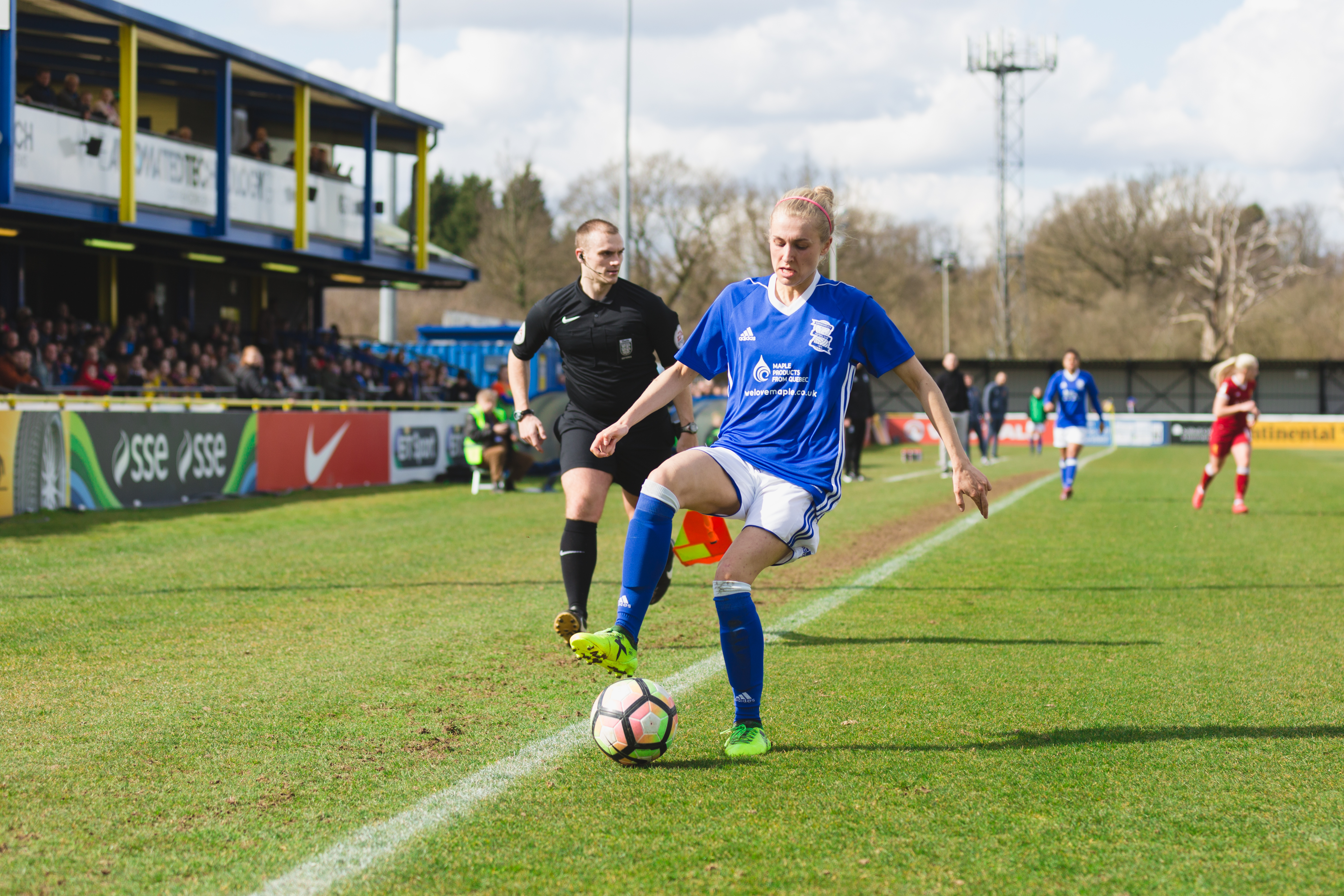 Birmingham City Ladies FC player turning the ball