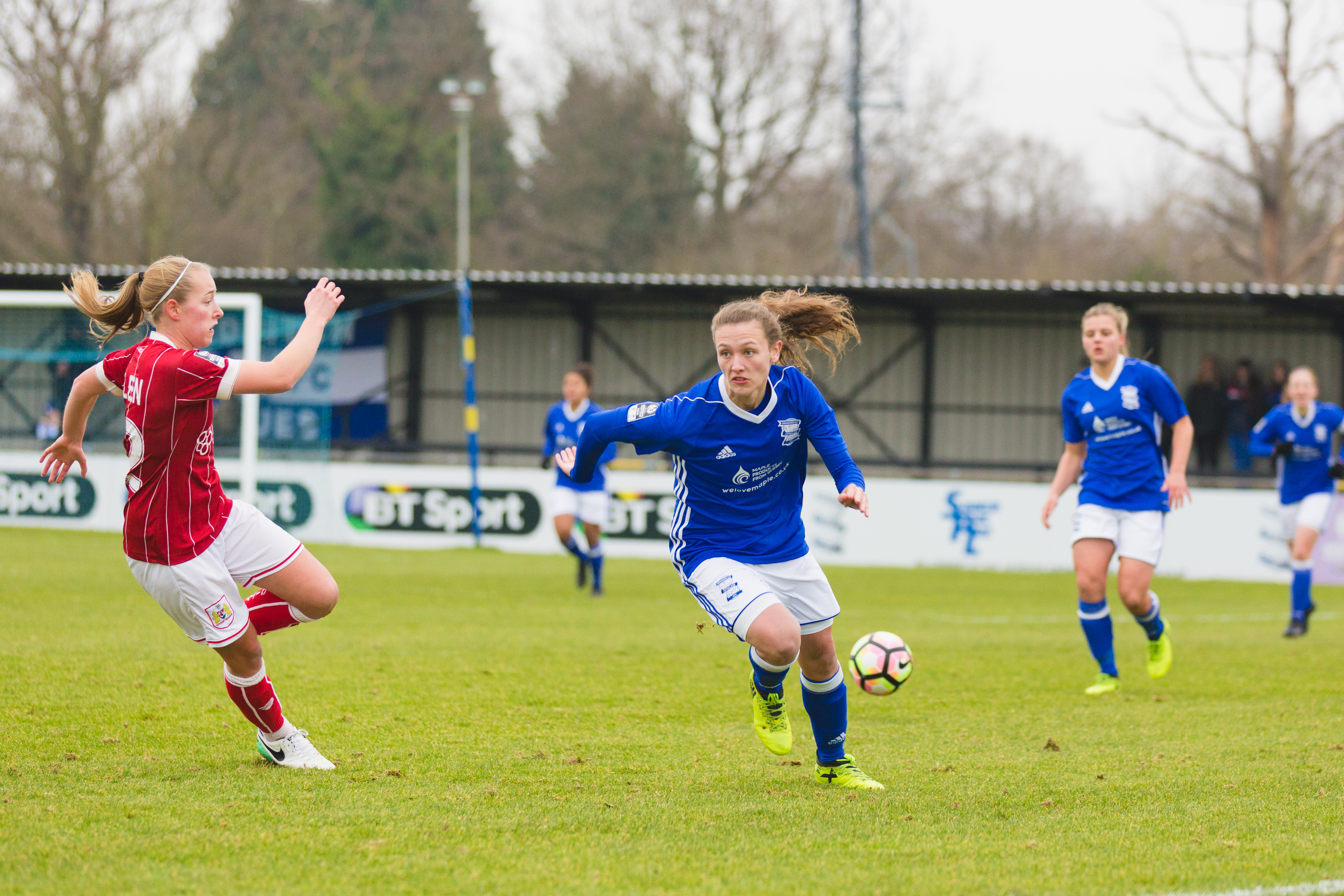Birmingham City Ladies FC player running with the ball
