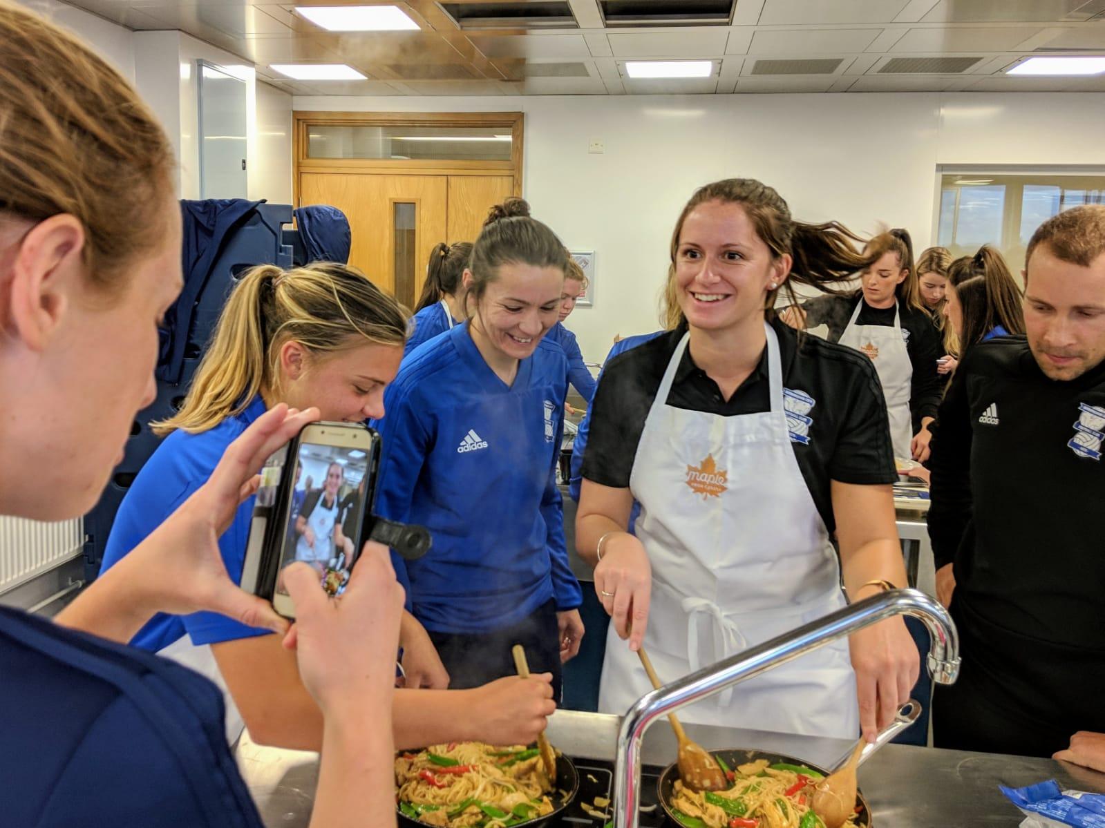 Birmingham City Ladies Fc players preparing the teriyaki stir fry