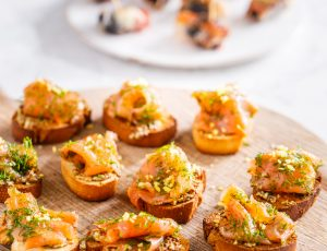 Cured salmon on butter toasts