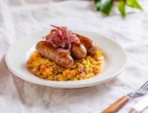 Toulouse sausage with maple-glazed onions and lentils