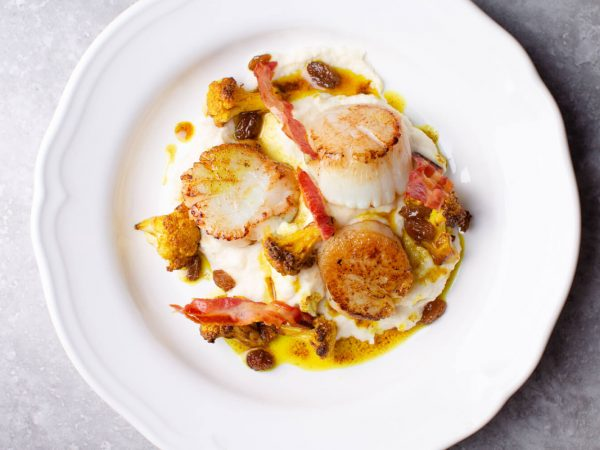 Seared scallops with maple roasted cauliflower and pancetta