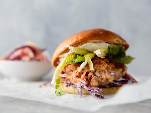 Spicy jerk chicken burger with maple slaw