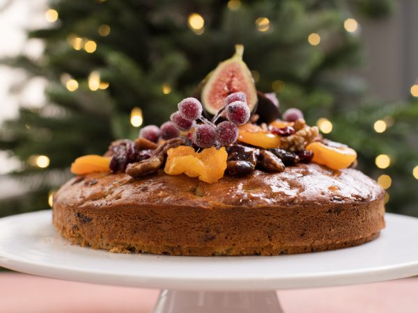 Christmas Maple Cake topped with fruit on plate